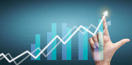 Hand touching a graphs of financial indicator and accounting market economy analysis chart