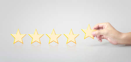 Five stars in hand. Increase rating evaluation and classification concept Zdjęcie Seryjne