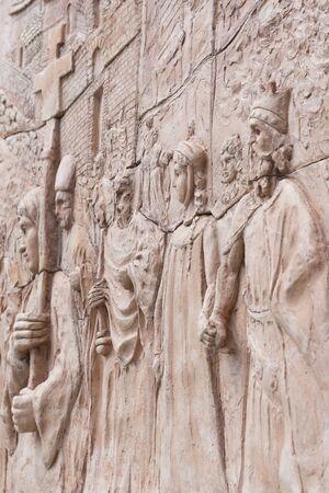 Old sculpture on brick wall Staiti - Fortunato Violi Sculpture