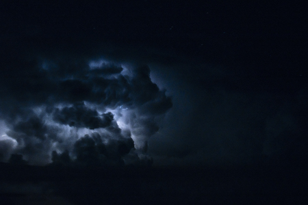 THUNDERSTORM WITH LIGHTNING IN THE SEA OF NIGHT