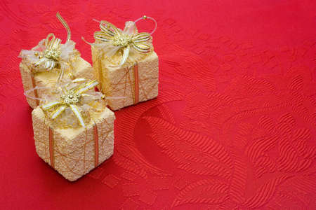Three gifts on red background with flowers Stock Photo - 736490