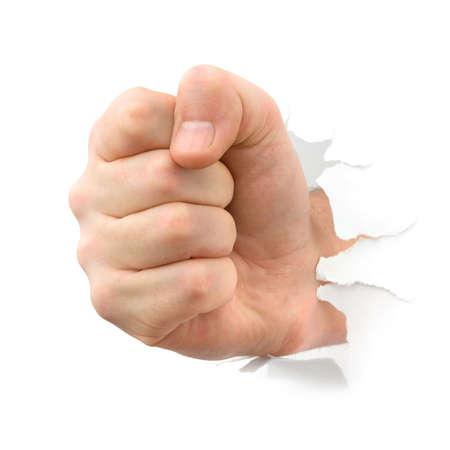 白い背景で隔離の紙を介してパンチの拳