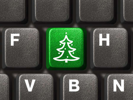 Computer keyboard with Christmas tree key, business concept Stock Photo - 3976204