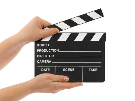 Cinema clapboard in hands isolated on white background photo