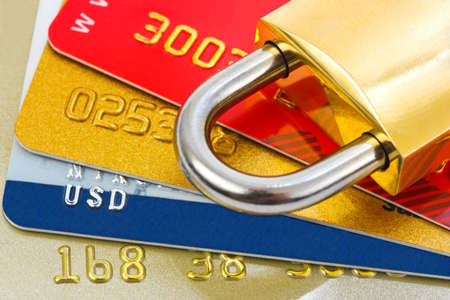 Credit cards and lock, business security background photo