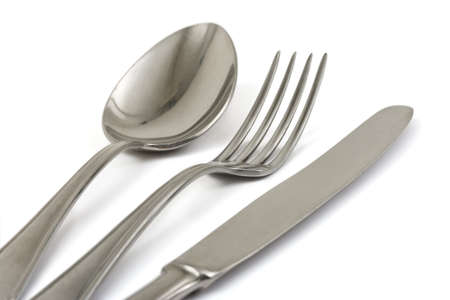 silver flatware: Fork, spoon and knife isolated on white background Stock Photo
