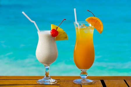 Two cocktails on table, sea background Stock Photo - 4288898