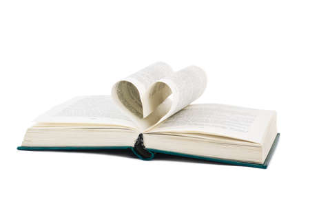Book and heart shaped pages isolated on white background photo