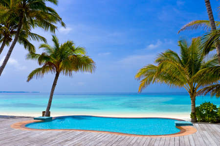 Pool on a tropical beach, vacation background photo