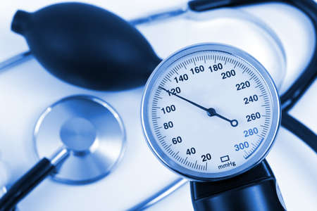 Scale of pressure and stethoscope, abstract medical background photo