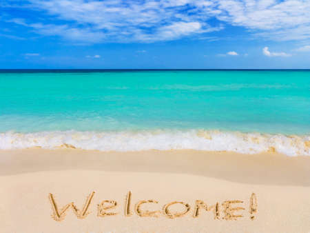 Word Welcome on beach, vacation concept background photo