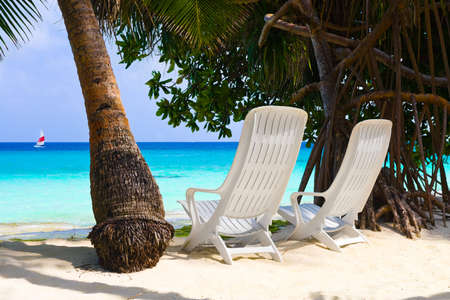 Chairs on tropical beach, abstract vacation background photo