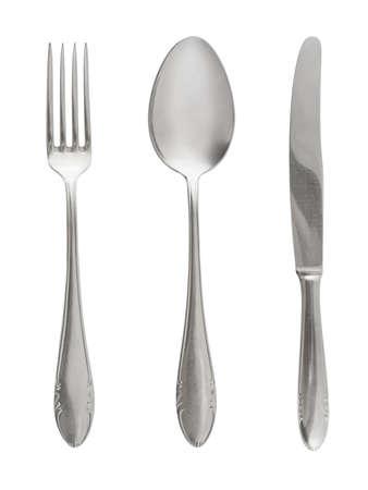 Tenedor, cuchara y cuchillo aisladas sobre fondo blanco