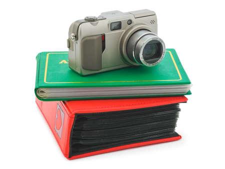 Camera and photo albums isolated on white background photo