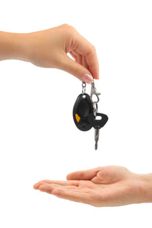 Hands and car key isolated on white background photo