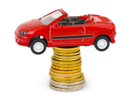 Toy car and stack of coins isolated on white background Stock Photo - 4470895