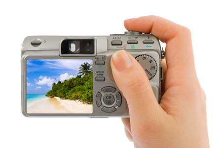 Hand with camera and landscape (my photo) isolated on white background photo