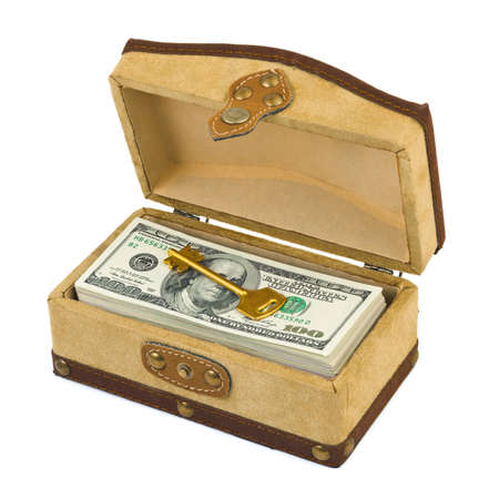 Money and key in box isolated on white background photo