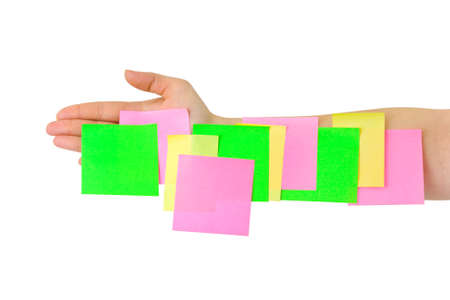 Hand and multicolored note paper isolated on white background photo