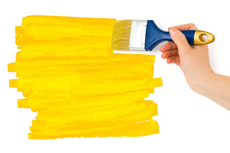 Hand with paintbrush isolated on white background photo