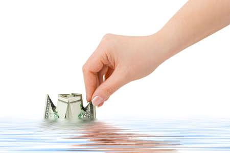 Hand launching money ship isolated on white background Stock Photo - 4554259