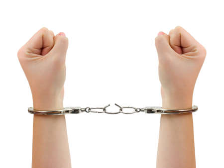Hands and breaking handcuffs isolated on white background photo