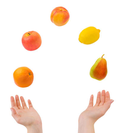Juggling hands and fruits isolated on white background photo