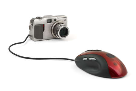 Photo camera and computer mouse isolated on white background photo