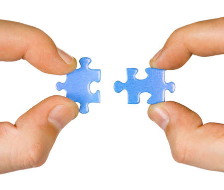 two pieces: Hands with puzzle isolated on white background Stock Photo