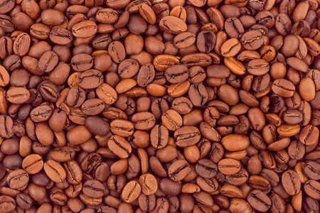 Brown coffee beans background, abstract food texture photo