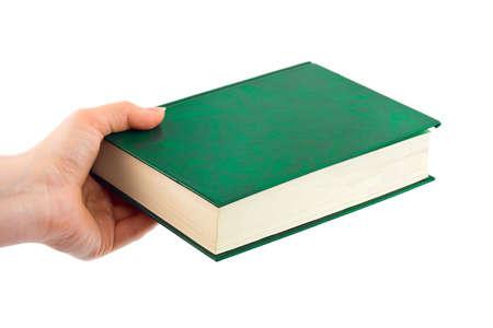 Libro en la mano aisladas sobre fondo blanco