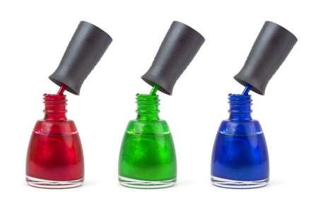Multicolored nail polish bottles isolated on white background photo