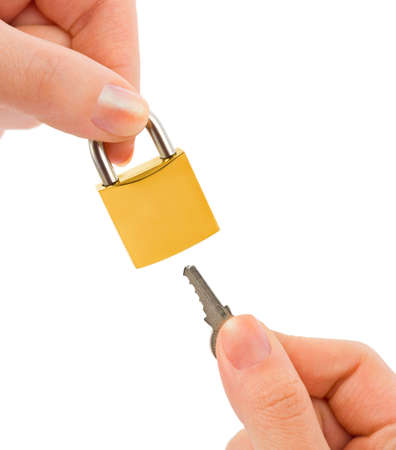 Lock and key in hands isolated on white background photo