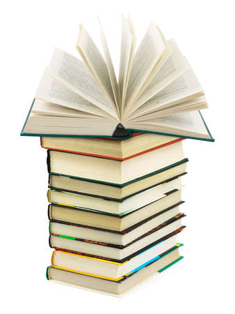 Opened book on stack isolated on white background