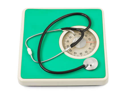 kilograms: Stethoscope on weight scale isolated on white background