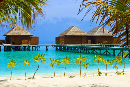 bungalows: Water bungalows on a tropical island - vacation background Stock Photo