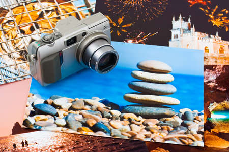 Camera and photo printouts (my photos), travel background photo