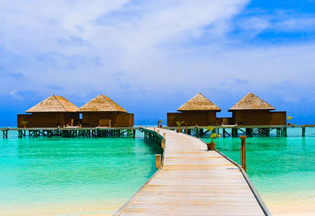 Water bungalows at a tropical island - travel background Stock Photo - 4718210