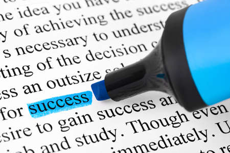 Highlighter and word success - concept business background photo