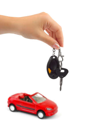 Hand with key and car isolated on white background photo
