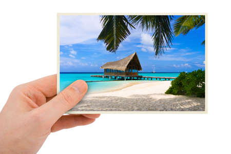 Photography in hand (my photo) isolated on white background photo