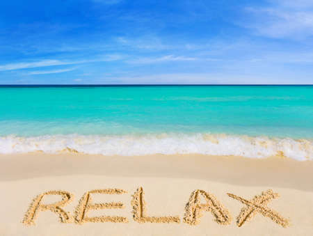 Word Relax on beach - vacation concept background photo