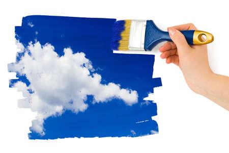 Hand with paintbrush painting sky isolated on white background Stock Photo - 4863033