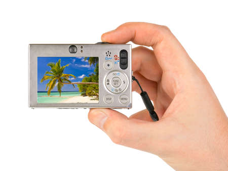 digicam: Hand with camera and landscape (my photo) isolated on white background