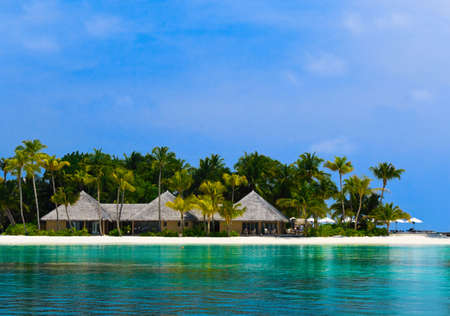 Water bungalows on a tropical island - travel background Stock Photo