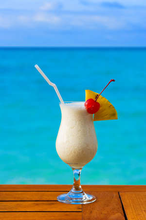 Milk cocktail on table at beach cafe - vacation background photo