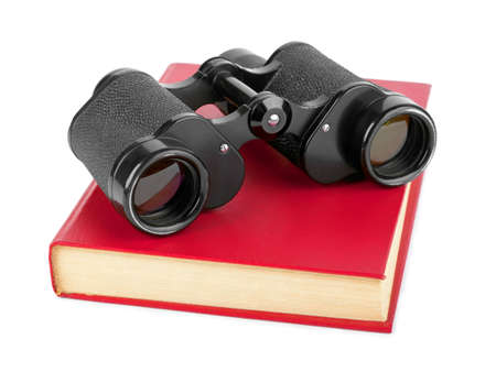 scientific literature: Book and binoculars isolated on white background Stock Photo