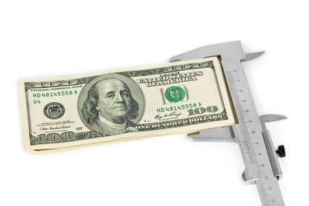Caliper and money isolated on white background photo