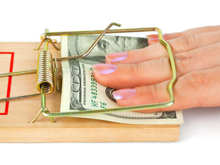 Hand and mousetrap with money isolated on white background photo