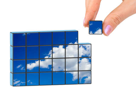 Hand and sky puzzle isolated on white background photo